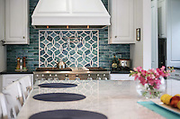 This custom backsplash features Polly, a handmade mosaic shown in Peacock Topaz and Absolute White from the Ann Sacks Beau Monde collection sold exclusively at www.annsacks.com<br />