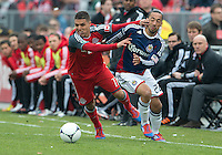 14 April 2012: Toronto FC midfielder Luis Silva #11 and Chivas USA midfielder Ryan Smith #22 in action during the first half in a game between Chivas USA and Toronto FC at BMO Field in Toronto.