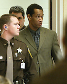 Sniper suspect John Allen Muhammad is escorted into court after a break during his trial in Virginia Beach Circuit Court in Virginia Beach, Virginia on November 9, 2003. <br /> Credit: Tracy Woodward - Pool via CNP