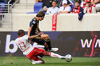 Jeremy Hall (17) of the New York Red Bulls goes in for a tackle on Jack McInerney (19) of the Philadelphia Union. The New York Red Bulls defeated the Philadelphia Union 2-1 during a Major League Soccer (MLS) match at Red Bull Arena in Harrison, NJ, on April 24, 2010.