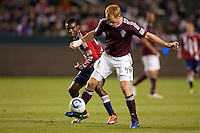 Colorado Rapids midfielder Jeff Larentowicz (4) steals the ball from CD Chivas USA forward Victor Estupinan (99). The Colorado Rapids defeated CD Chivas USA 1-0 at Home Depot Center stadium in Carson, California on Saturday March 26, 2011...