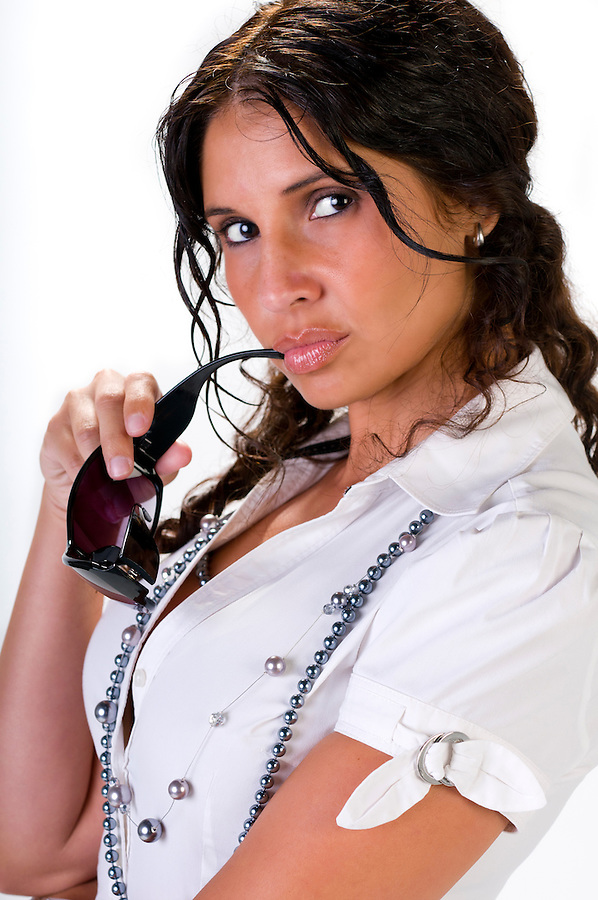 Hispanic businesswoman posing with sunglasses very sensual