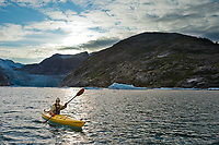 Kayaker in Nellie Juan Lagoon, Prince William Sound, Chugach National Forest, Kenai Peninsula, southcentral, Alaska.