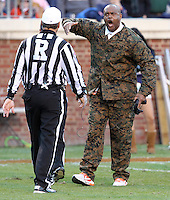 CHARLOTTESVILLE, VA- NOVEMBER 12: Head coach Mike London of the Virginia Cavaliers reacts to a play with the referee during the game against the Duke Blue Devils on November 12, 2011 at Scott Stadium in Charlottesville, Virginia. Virginia defeated Duke 31-21. (Photo by Andrew Shurtleff/Getty Images) *** Local Caption *** Mike London
