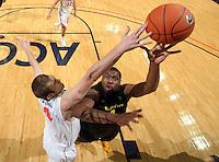 Dec. 17, 2010; Charlottesville, VA, USA; Oregon Ducks forward Joevan Catron (34) is defended by Virginia Cavaliers forward Will Regan (4) during the game at the John Paul Jones Arena. Virginia won 63-48. Mandatory Credit: Andrew Shurtleff
