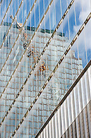 Reflection of a crane in a skyscraper window, Ground Zero, NYC, USA