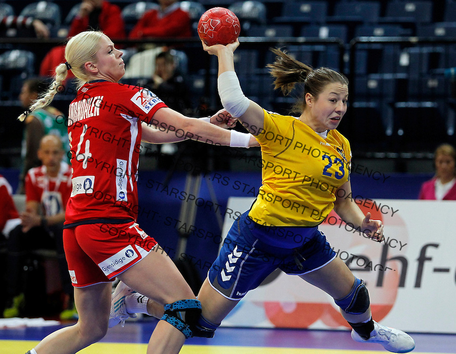 BELGRADE, SERBIA - DECEMBER 08: Iryna Glibko (R) of Ukraine try to score near Ida Bjorndalen (L) of Norway during the Women's European Handball Championship 2012 Group A match between Norway and Ukraine at Arena Hall on December 08, 2012 in Belgrade, Serbia. (Photo by Srdjan Stevanovic/Getty Images)