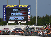 Jun 3, 2016; Epping , NH, USA; Detailed view of the Sunoco Vision big screen showing New Track Record on the screen during NHRA qualifying for the New England Nationals at New England Dragway. Mandatory Credit: Mark J. Rebilas-USA TODAY Sports