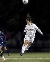 "Boston College forward Jill MacNeil (15) heads the ball. Boston College defeated West Virginia, 4-0, in NCAA tournament ""Sweet 16"" match at Newton Soccer Field, Newton, MA."