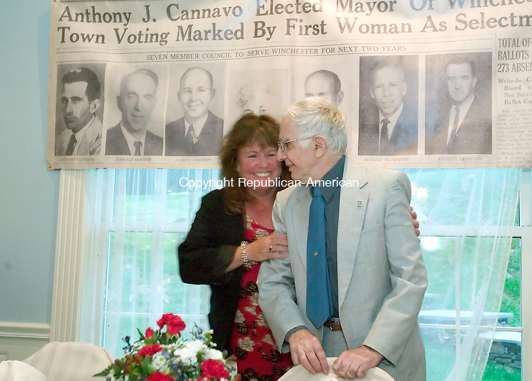 WINSTED CT-19 AUGUST 2006-081906JS01-Tony Cannavo, a legend in local politics and business in Winsted, gets a hug from his daughter-in-law Nancy Cannavo during a testimonial dinner Saturday at Crystal Peak in Winsted.  --Jim Shannon Republican-American