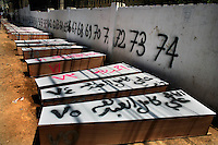 Tyr, Lebanon, July 21 2006.More than 80 Israeli bombardment victims' bodies have been kept in refrigerated trucks for several days by the Lebanese authorities to allow for identifications before being put in coffins labeled with their names and details to be buried in a mass grave nearby.