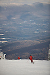 Skiers and Riders enjoying the snow at Stowe Mountain Resort, Stowe, Vermont.  Stowe is one of Vermont's most famous winter resorts.  LICENSE FOR EDITORIAL USE ONLY.