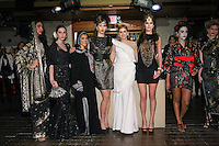 Fashion stylist Engie Hassan (white dress), poses with models during the EngieStyle one year anniversary, &quot;A Tale of the Black Dress&quot;, fashion presentation.
