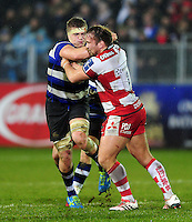 Tom Ellis of Bath Rugby looks to fend Paul Doran-Jones of Gloucester Rugby. Anglo-Welsh Cup match, between Bath Rugby and Gloucester Rugby on January 27, 2017 at the Recreation Ground in Bath, England. Photo by: Patrick Khachfe / Onside Images