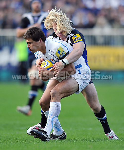 Ignacio Mieres is tackled in possession by Tom Biggs. Aviva Premiership match, between Bath Rugby and Exeter Chiefs on October 27, 2012 at the Recreation Ground in Bath, England. Photo by: Patrick Khachfe / Onside Images