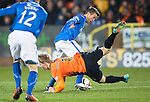 Dundee United v St Johnstone...12.03.14    SPFL<br /> Gary Mackay-Steven is sent flying by a crunching tackle from Chris Millar<br /> Picture by Graeme Hart.<br /> Copyright Perthshire Picture Agency<br /> Tel: 01738 623350  Mobile: 07990 594431