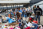 Refugees look for clothes donated by Hungarians at a makeshift refugee camp, at the Budapest Keleti railway station.<br /> <br /> Hundreds of refugees from mostly Syria and Afghanistan gather at the Budapest Keleti railway station waiting for trains to leave for destinations such as Austria, Germany and Sweden, in Budapest, Hungary, on Tuesday, Sept. 8, 2015. Hungary's Prime Minister Viktor Orban created an anti-refugee campaign to generate hate against those fleeing war in their home countries. The country is currently 50% xenophobic and the government has become increasingly authoritarian.