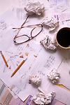 Small Home Business (man/woman) working on end of the year Taxes (IRS) frustrated, angry with crumpled paper and broken pencil, Marysville, Washington USA