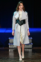 "Model walks runway in an outfit from the [ep_anoui] F/W 12/13, ""l'air de vivre"" collection, by Austrian designer Eva Poleschinski, during Slovak Fashion Night 2012 in New York City May 11, 2012."