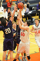 NWA Democrat-Gazette/FLIP PUTTHOFF <br />Nick Lowery (40) shoots for the Mountaineers     Feb. 14 2017     against Bulldog defenders.