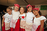 Multiethnic girls in the Italian dance group pose for a picture at the Galbani Italian Feast of San Gennaro in Los Angeles, CA