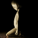 portrait of kneeling doll child