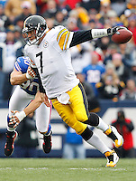 BUFFALO, NY - NOVEMBER 28:  Ben Roethlisberger #7 of the Pittsburgh Steelers evades a tackle from Chris Kelsay #90 of the Buffalo Bills during the game on November 28, 2010 at Ralph Wilson Stadium in Orchard Park, New York.  (Photo by Jared Wickerham/Getty Images)