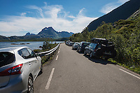 Busy parking area in summer at hiking trail to Kvalvika beach, Moskenesøy, Lofoten Islands, Norway