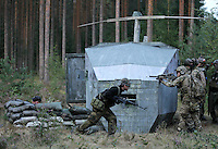 Players from team SOB remove the flight recorder from a downed &quot;helicopter&quot;, thus completing one of their missions.<br /> <br /> Airsoft players fight during the mock war &quot;Ghost Zone&quot;. The game attracted around 140 players from all over Norway, and is the biggest such event in the country. Dressed in full military gear, complete with replica weapons, players from the two teams Goyo and SOB fought each other to control territory, drugs and money. The guns, softguns, weigh and feel like real weapons but only shoot little plastc pellets. All players wear protective glasses for their eyes, but the pellets are otherwise not considered dangerous.