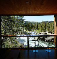 The Arkansas River fills the window frame of this modern cabin that has a spectacular view of the surrounding country