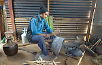 Mithe, a blacksmith in Dhawa, a village in the Gorkha District of Nepal, works on a metal pot in his workshop. In Nepal's caste system, blacksmiths are near the bottom, but helping them recover their livelihoods after a 2015 earthquake ravaged their community has been a priority for some aid agencies.
