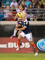 Sydney Leroux (14) of the USWNT collides on a header with Rhonda Jones (2) of Scotland during the game at EverBank Field in Jacksonville, Florida.  The USWNT defeated Scotland, 4-1.