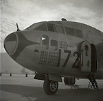 A C-119 flying box car has a tally the missions it has flown as nose art during the Korean War.