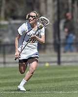 Boston College midfielder Kate McCarthy (20) brings the ball forward. Boston College (white) defeated Duke University (blue), 10-9, on the Newton Campus Lacrosse Field at Boston College, on April 6, 2013.