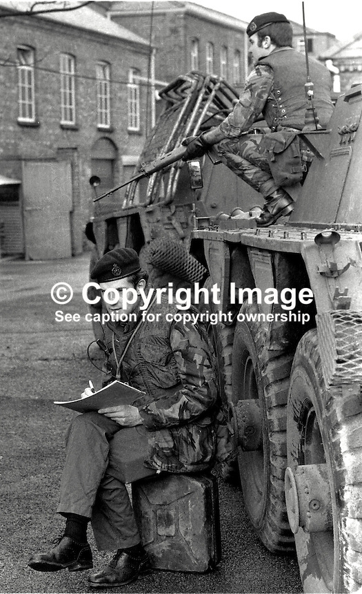 Major Chris Miers, the British Army's official war artist, at work in Belfast,  during the N Ireland Troubles. Whilst be sketches a bodyguard remains vigilant. Major Miers is serving with the Royal Green Jackets. 197211200731b.<br /> <br /> Copyright Image from Victor Patterson, 54 Dorchester Park, Belfast, UK, BT9 6RJ<br /> <br /> t1: +44 28 9066 1296 (from Rep of Ireland 048 9066 1296)<br /> t2: +44 28 9002 2446 (from Rep of Ireland 048 9002 2446)<br /> m: +44 7802 353836<br /> <br /> e1: victorpatterson@me.com<br /> e2: victorpatterson@gmail.com<br /> <br /> The use of my copyright images is subject to my Terms &amp; Conditions.<br /> <br /> It is IMPORTANT that you familiarise yourself with them. They are available on my website at www.victorpatterson.com.<br /> <br /> None of my copyright images may be used on a website unless they are visibly watermarked, i.e. &copy; Victor Patterson within the body of the visible image. Metadata denoting my copyright must NOT be deleted. <br /> <br /> Web use is extra at currently recommended NUJ rates.