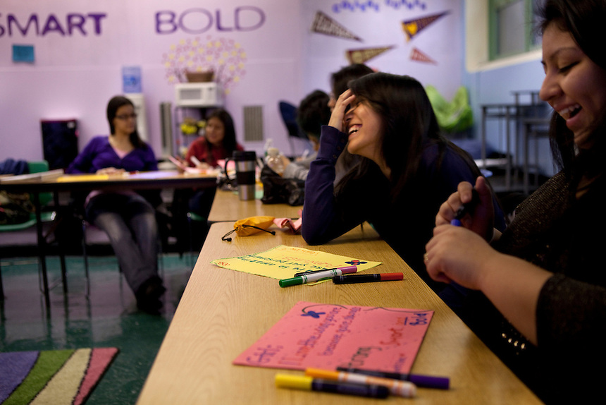 Elvira Quintero, 17, right, and Denise Siguencia, 17, far right, write affirmative posters during Girls Inc Leadership class at Central Park East High School in New York, NY on November 15, 2012. Beyond sheer physical safety, a look at how schools and sitricts can create classroom conditions in which students are able to engage enthusiastically and without emotional fear of stepping forward. Photographer: Melanie Burford/Prime