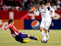 Chivas USA defender Mariano Trujillo (8) attempts a tackle on Real Salt Lake midfielder Javier Morales (11). Real Salt Lake defeated CD Chivas USA 2-1at Home Depot Center stadium in Carson, California on Saturday May 22, 2010.  .