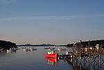 sailboats and fishing boats in bar harbor near sunset