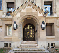 Entrance to the Fondation des Etudiants Armeniens, designed by Leon Nafilyan, 1877-1937, in Armenian style and inaugurated in 1930, in the Cite Internationale Universitaire de Paris, in the 14th arrondissement of Paris, France. The CIUP or Cite U was founded in 1925 after the First World War by Andre Honnorat and Emile Deutsch de la Meurthe to create a place of cooperation and peace amongst students and researchers from around the world. It consists of 5,800 rooms in 40 residences, accepting another 12,000 student residents each year. Picture by Manuel Cohen