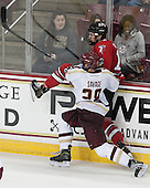 Scott Savage (BC - 28), Johnny Rogic (RPI - 12) - The Boston College Eagles defeated the visiting Rensselaer Polytechnic Institute Engineers 7-2 on Sunday, October 13, 2013, at Kelley Rink in Conte Forum in Chestnut Hill, Massachusetts.