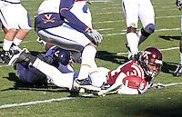 Nov 27, 2010; Charlottesville, VA, USA; Virginia Tech Hokies running back Ryan Williams (34) scores a touchdown in front of Virginia Cavalier defenders during the game at Lane Stadium. Virginia Tech won 37-7. Mandatory Credit: Andrew Shurtleff
