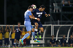 04 October 2016: North Carolina's Alex Comsia (CAN) (4) heads the ball away from UNCW's Stian Sandbekkhaug (19). The University of North Carolina Tar Heels hosted the UNC Wilmington Seahawks at Fetzer Field in Chapel Hill, North Carolina in a 2016 NCAA Division I Men's Soccer match. UNC won the game 1-0.