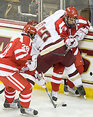 Sahir Gill (BU - 28), Philip Samuelsson (BC - 5), Joe Pereira (BU - 6) - The Boston College Eagles defeated the visiting Boston University Terriers 5-2 on Saturday, December 4, 2010, at Conte Forum in Chestnut Hill, Massachusetts.