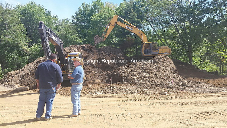 THOMASTON, CT, 05 June 2015 - 060515LW01 - Greg Green, left, chats with his father, Steve Green, who was checking in on the construction progress at Nystrom's Park in Thomaston Friday morning. Green was drying dirt to be screened for Green and Sons, a sub-contractor for Green Stone Landscaping. Laraine Weschler Republican-American