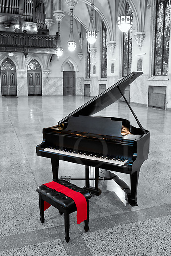 A black grand piano waits for someone to accept its invitation to come and play in this beautiful old church, one that has been converted to a social hall and concert venue. A red sash highlights the bench and the soundboard shows gold inside the dark case. The other colors have been left to black and white in this modern day digital hand tint, and all that remains to bring them back to life is the imagination to play this piano. Oz awaits you.<br /> <br /> This building is a Gothic architecture world that has high vaulted ceilings with arches and an elevated choir loft with large organ pipes behind. All the large German style stained glass windows are intact. Just as there is a grand beauty in this interior, the reverberation in this room for music is the same although it can&rsquo;t be seen, only felt.<br /> <br /> This old Catholic church building itself dates from 1908 and was originally a German immigrant parish in the Cambria City section of Johnstown, PA. There were once many Catholic churches in that one small section of the city, so in recent times of reduced population the diocese consolidated the parishes and sold the buildings, some of which were gathered up by a preservation society called The Steeples Project who now run this rental hall. For information about them and this very beautiful building, go to http://www.steeplesproject.org<br /> <br /> Monthly Newsletter sign up at Dierks Photo on Facebook...