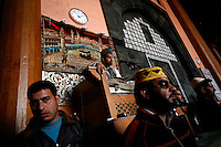Friday prayer at the Jamia Masjid mosque led by seperatist leader Umar Mirwaiz. Heading the Hyrriyat Conference, a coalition of seperatist parties, the cleric and politician is considered to be a moderate.  Body guards stand in front. Srinagar, Kashmir, India. © Fredrik Naumann/Felix Features