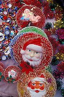 Santa Clauses and other Christmas decorations for sale in the market in Angangueo, Michoacan, Mexico. Angangueo is the starting point for visits to the El Rosario and Sierra Chincua monarch butterfly sanctuaries.