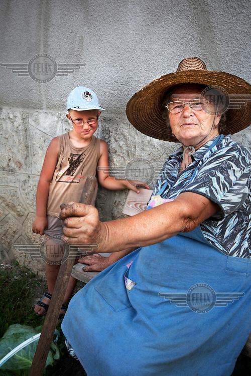 A grandmother with her grandson in Rimtea (Hun: Torocko) an ethnic Hungarian village.