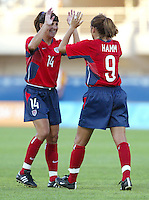 August 11th, 2004:  Mia Hamm celebrates with Joy Fawcett after Hamm scored a goal during the second half of the game against Greece at Pankritio Stadium in Heraklio, Greece.  USA defeated Greece, 3-1..Credit: Michael Pimentel / ISI