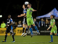 Sam Cronin of Earthquakes fights for the ball in the air against Brad Evans of Sounders during the game at Buck Shaw Stadium in Santa Clara, California on April 2nd, 2011.   San Jose Earthquakes and Seattle Sounders are tied 1-1 at halftime.